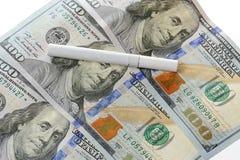 在美元的香烟 免版税库存图片