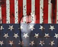 在美国国旗的颜色绘的拳头的图片 免版税图库摄影