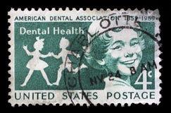 在美国打印的邮票显示孩子,牙齿健康 免版税库存图片
