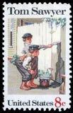 在美国打印的邮票由诺曼・洛克威尔显示绘画`汤姆・索亚`, 免版税库存照片