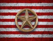 在美国旗子背景的古铜色星 库存图片