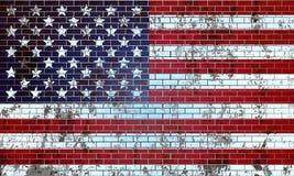 在美国旗子绘的老砖墙 库存照片