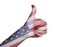 在美国的旗子报道的手 库存图片