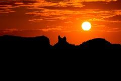 在美国163风景路的日落向纪念碑谷公园 库存图片