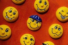 在美好的背景的玩具微笑 库存图片