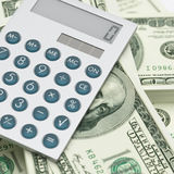 在美金顶部的计算器 免版税库存照片