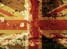 在老墙壁上的难看的东西英国旗子 免版税图库摄影