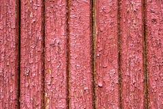 在老委员会的门的切削的油漆构造背景 库存照片