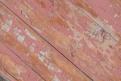 在老委员会的门,纹理背景的切削的油漆 免版税库存照片