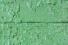 在老委员会的门,纹理背景的切削的油漆 库存照片