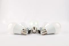 在老对经济和不伤环境的光的白炽,用途的几个LED节能电灯泡 免版税图库摄影