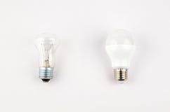 在老对经济和不伤环境的光的白炽,用途的几个LED节能电灯泡 图库摄影