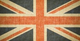 在老帆布纹理的英国旗子背景 库存图片