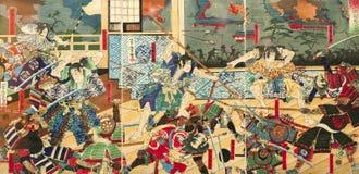 在老日本传统绘画的武士争斗 库存图片