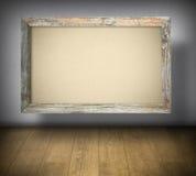 在老木制框架的空白的帆布 免版税库存照片