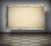 在老木制框架的空白的帆布 库存照片