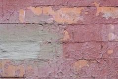 在老混凝土墙,纹理背景上的切削的油漆 免版税库存照片