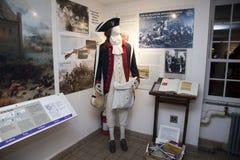 在老石议院里面的英国一致的时装模特 免版税库存图片