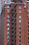 在老砖瓦房的防火梯 免版税图库摄影