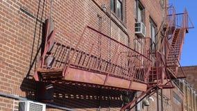 1912087在老砖瓦房的防火梯 库存图片