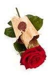 在老羊皮纸的红色玫瑰 图库摄影