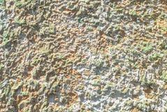 在老膏药墙壁纹理背景的切削的油漆 库存图片