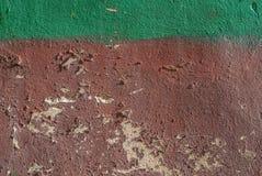在老膏药墙壁纹理背景的切削的油漆 图库摄影