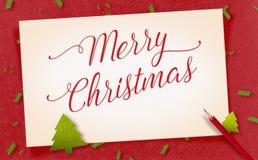 在老葡萄酒纸工艺的圣诞快乐词与礼物和 库存照片