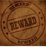 在老褐色被弄皱的纸的奖励邮票 免版税库存照片