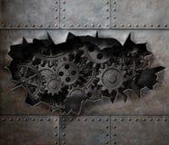 在老金属的被撕毁的孔与生锈的齿轮和嵌齿轮 免版税图库摄影