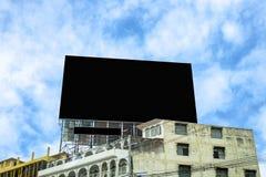 在老镇的黑广告牌 免版税图库摄影