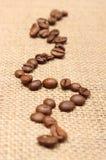 在老织品的咖啡粒 库存照片