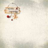 在老织地不很细织品的背景的圣诞节中看不中用的物品 免版税图库摄影
