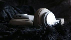 在耳朵耳机的立体声低音 库存照片
