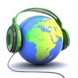 在耳机的地球 库存图片
