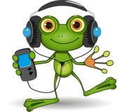 在耳机的青蛙 免版税库存照片