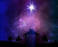 在耶稣基督小屋的圣诞节星空间背景的 免版税库存照片