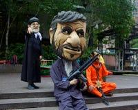 在联合国抗议的中东讽刺画在纽约 库存照片