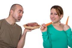 在肉或菜之间的决定 免版税库存照片