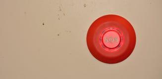 在肮脏的墙壁上的Sos按钮 库存图片