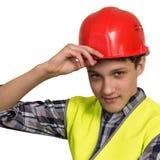 在背心和盔甲的年轻建造者 免版税图库摄影