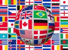 在背景的地球与世界的旗子 免版税库存图片