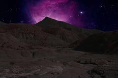 在背景的山土坎星云 库存照片