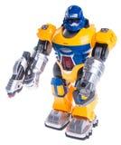 在背景的玩具机器人 免版税图库摄影