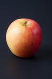在背景的红色苹果 免版税库存图片