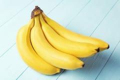 在背景的美味的香蕉 免版税库存照片