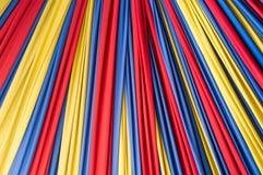 在背景的色的织品 免版税库存图片