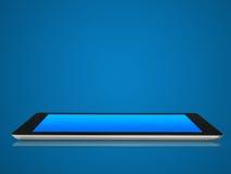 在背景的蓝色颜色的片剂设备 库存照片