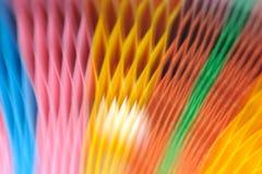 在背景的被弄脏的五颜六色的纸 图库摄影