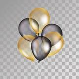 在背景的金透明气球 库存图片